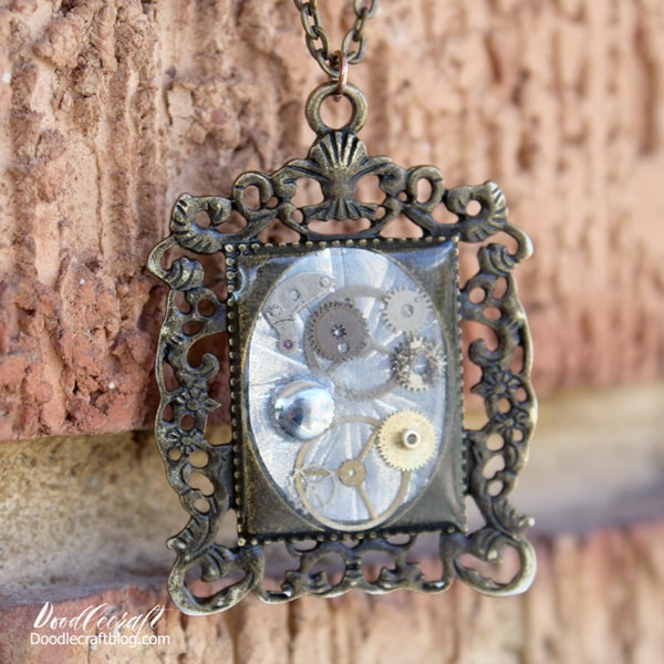 Steampunk pendant necklace using jewelry resin and watch parts.