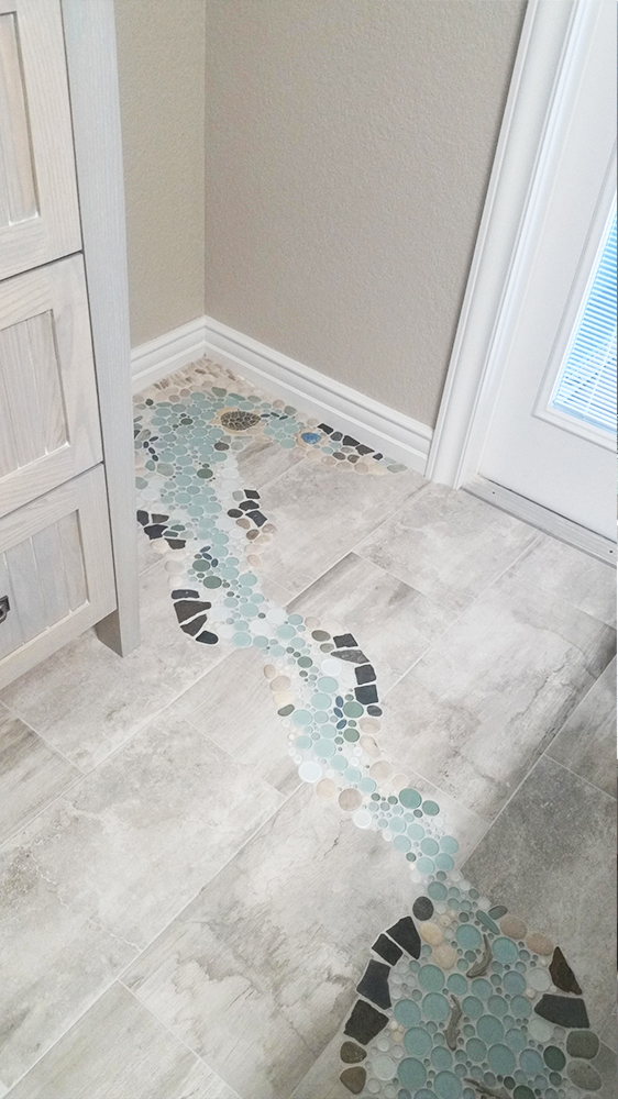 A fun bathroom waterfall design the wet dog blog for Crossing the shallows tile mural