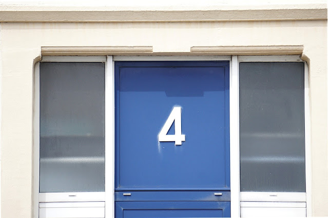 Door decoration with adhesive numbers