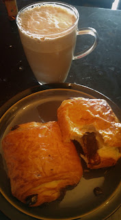 Chocolate croissant and capuccino
