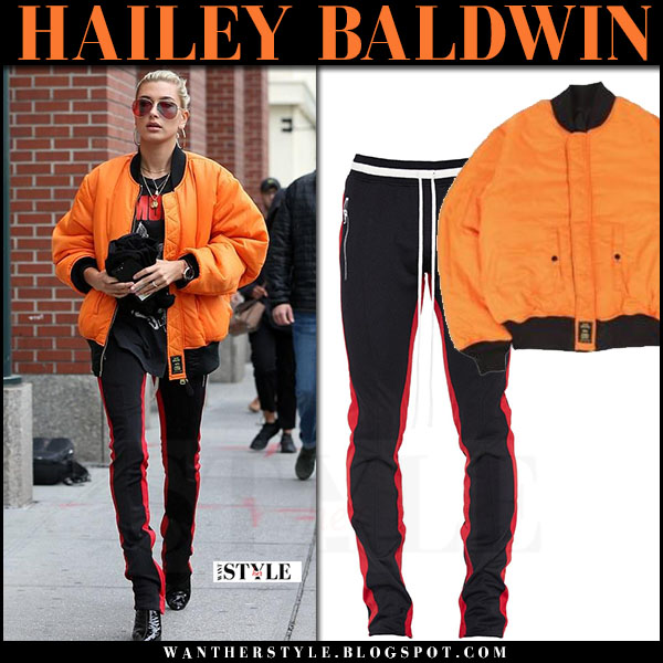 Hailey Baldwin in orange bomber jacket alpha industries and black red stripe track pants fear of god what she wore june 4 2017