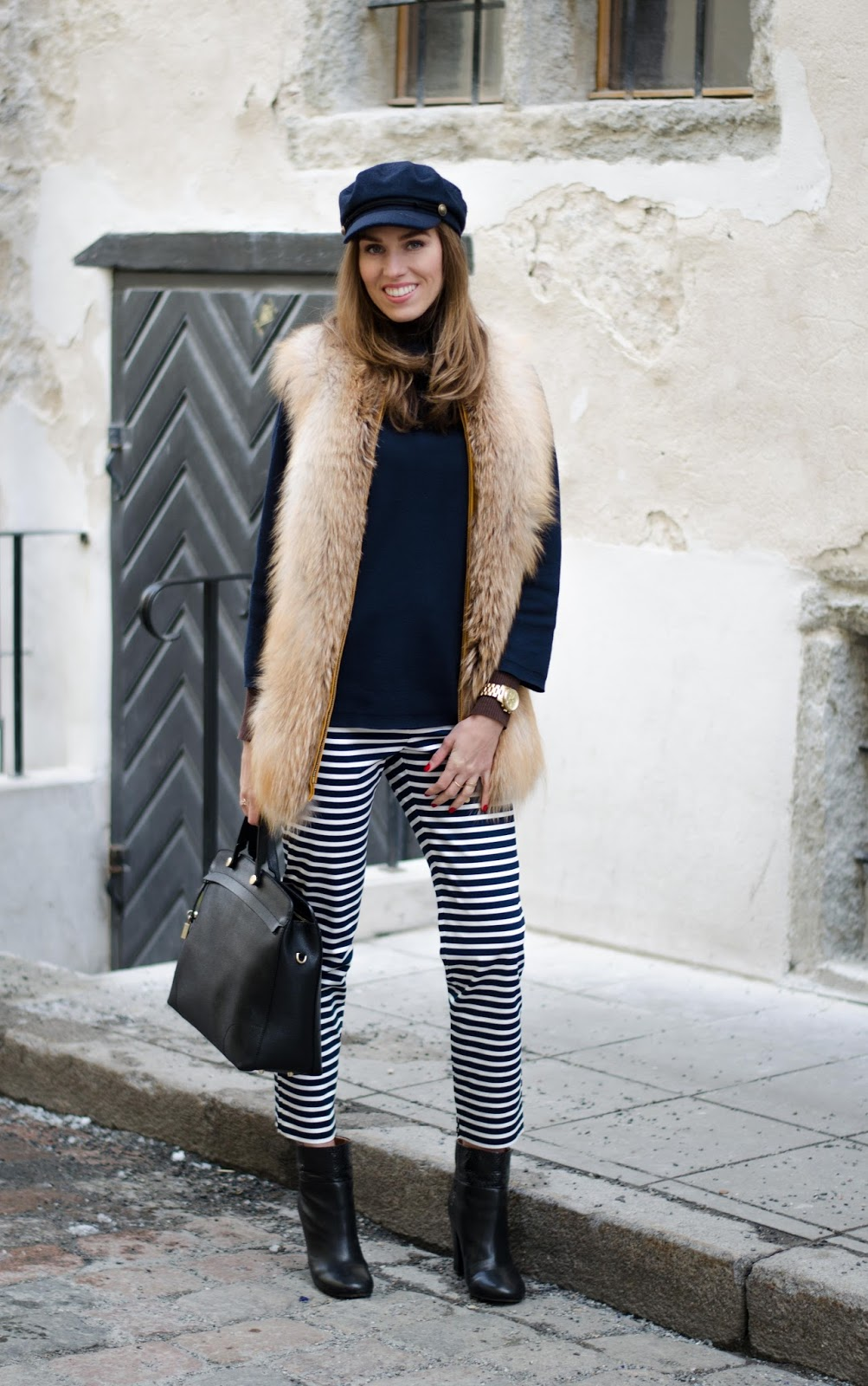 kristjaana mere striped ankle pants sweater fur vest spring fashion