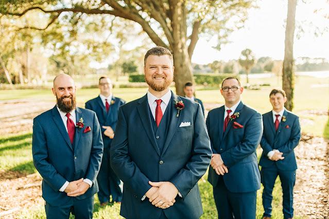 groom and groomsmen in navy