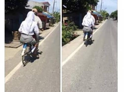 Foto Seorang Ayah yang sedang Antar Anaknya Sekolah menggunakan Sepeda Ontel ini Viral di Media Sosial