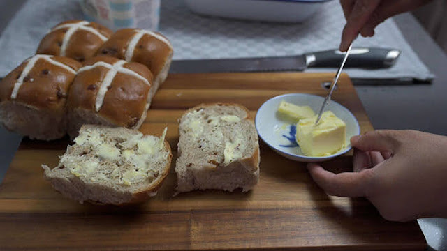 Slather butter on to hot cross buns