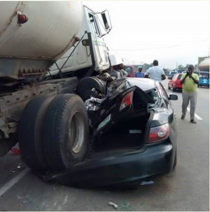 Tanker Climbs Over Nigerian OAP's Car... he came out alive