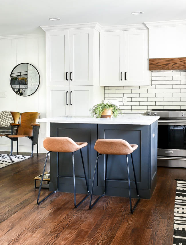 White open kitchen with dark gray island