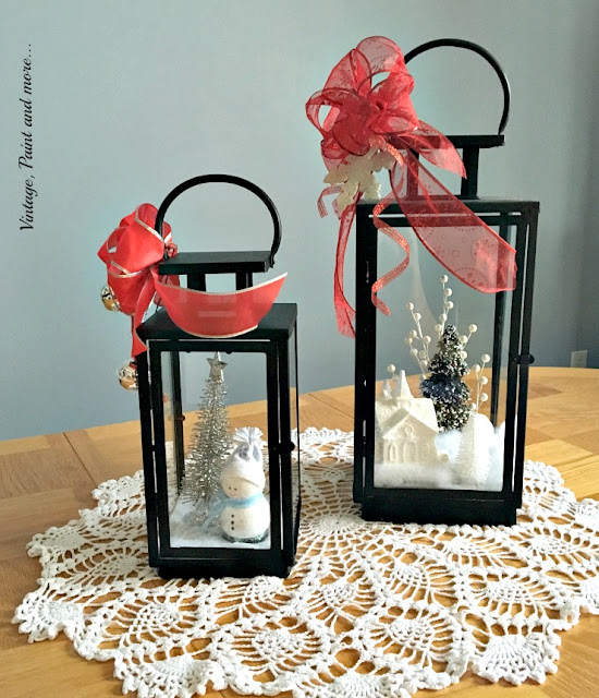 upcycled lanterns with winter scenes used as table centerpiece