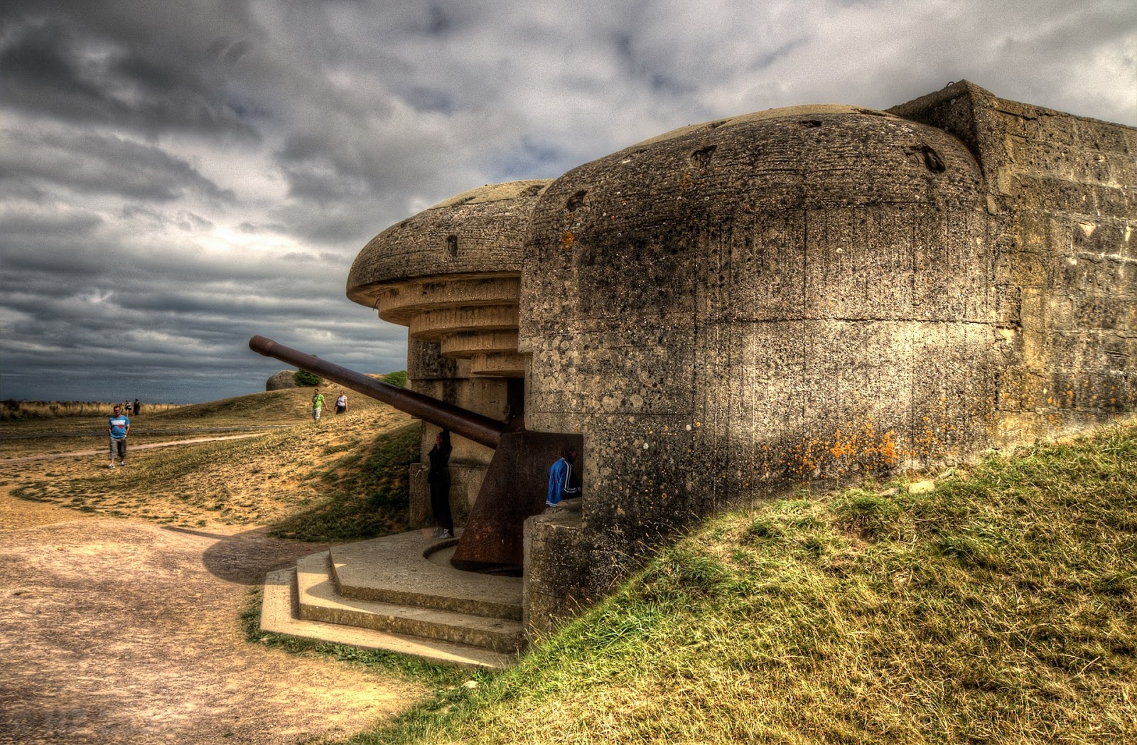 a world war 2 era german bunker overlooks the ocean to illustrate a blog post about the movie d-day survivor