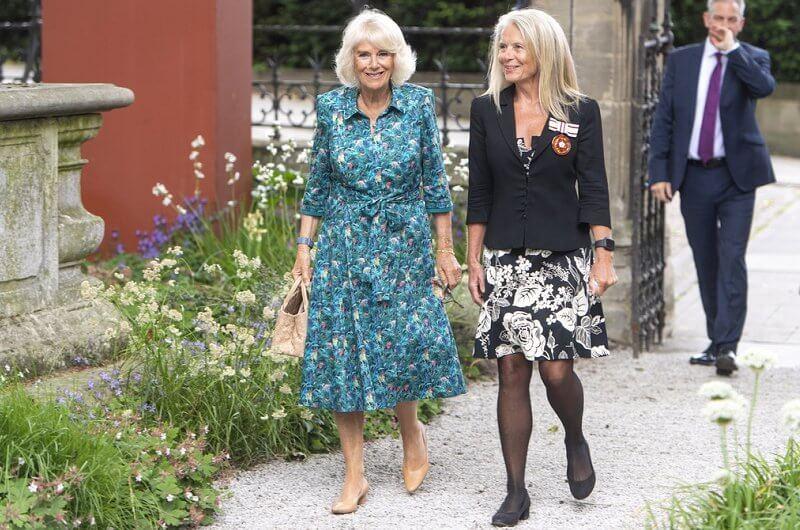 The Duchess wore a new floral print silk shirt dress. The Duchess carried a totally on-trend woven bag from Bottega Veneta