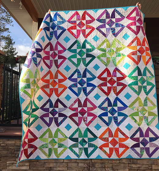 Twisted Blossom Quilt Free Tutorial designed by Sew Kind of Wonderful