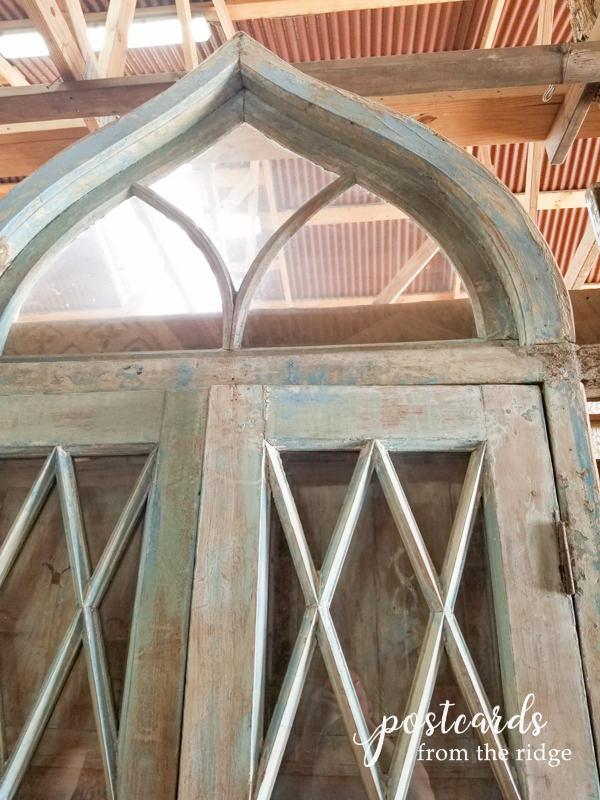 salvaged antique door with fretwork