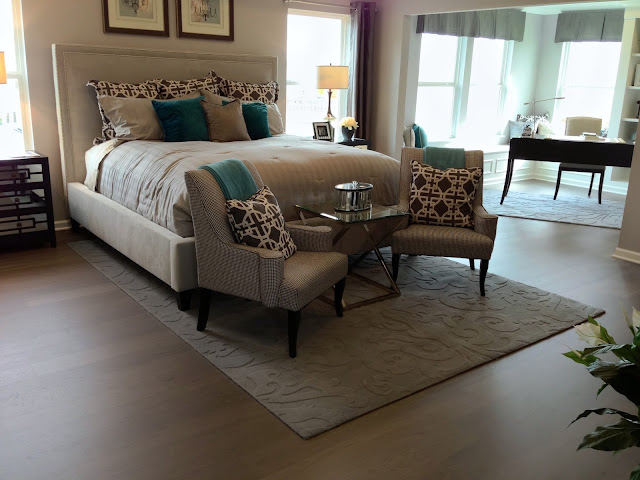 An area rug adds a touch of softness and layered design in the bedroom