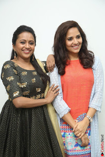 Actress Suma in Black Salwar Suit and Anusuya in orange Dress at winner movie press meet part 1 February 2017 (41).JPG