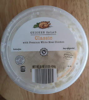 Overhead view of a tub of Little Salad Bar Classic Chicken Salad, from Aldi