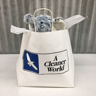 A freshly cleaned stuffed elephant in an A Cleaner World Bag