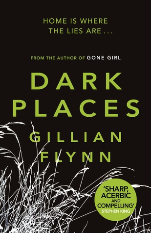 """The cover of """"Dark Places"""" by Gillian Flynn. The title is in a lime green sans-serif font on a black back background, with a photo negative image of weeds in the bottom left corner."""