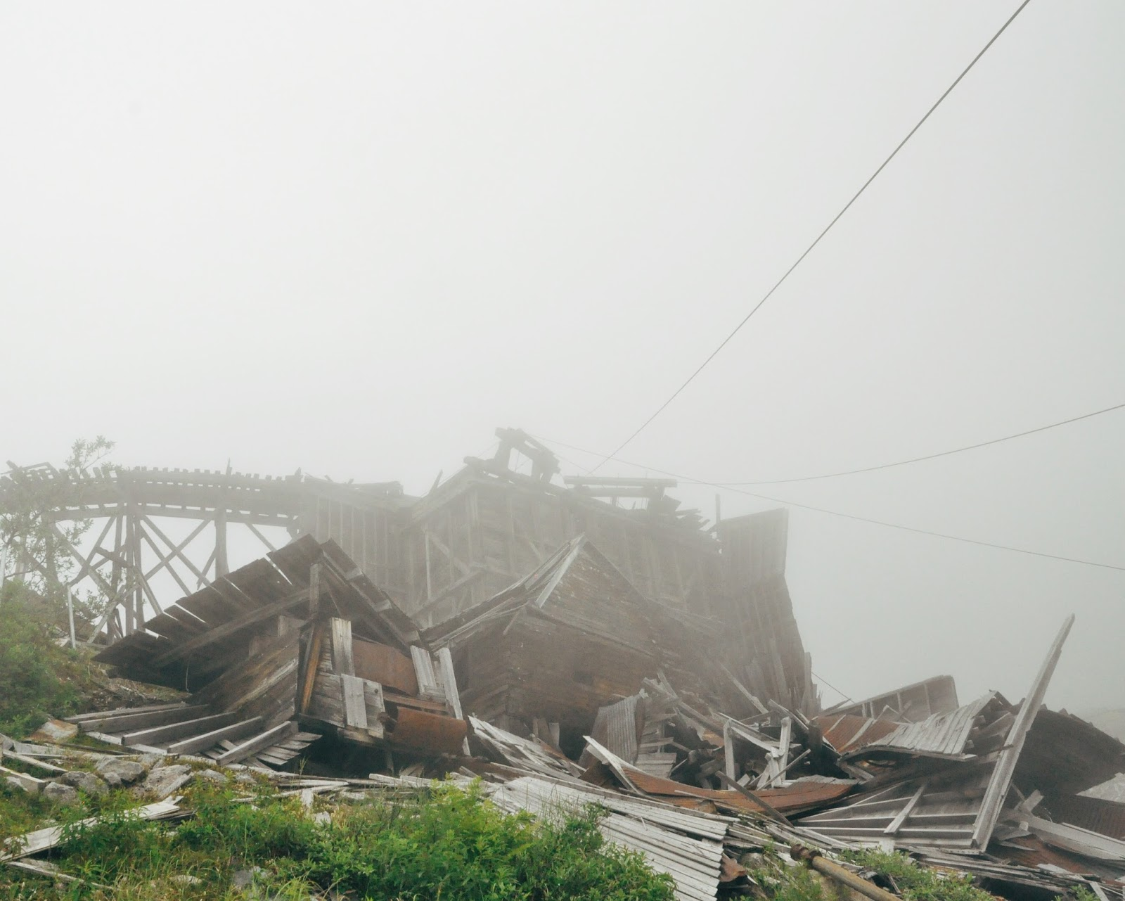 abandoned gold mine buildings fog