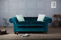 Aubergine velvet sofa in grey living room
