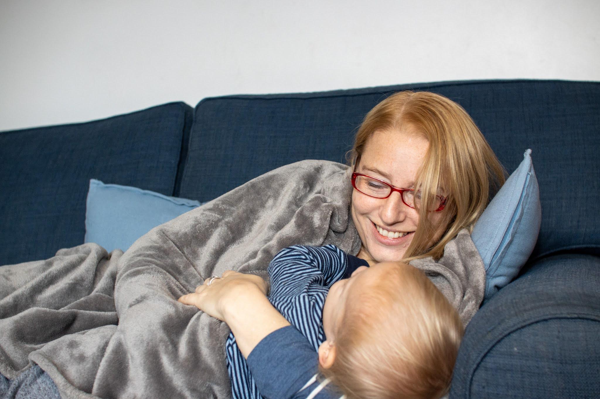 Me on the sofa cuddling my son