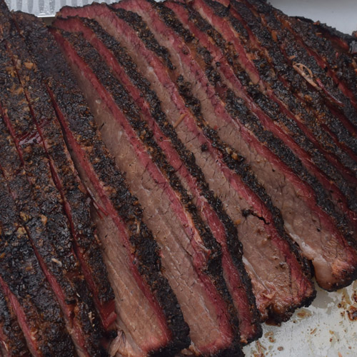 Sliced brisket flat - notice the dark bark and deep smoke ring.