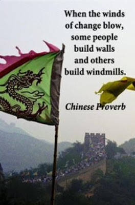 trump wall meme: chinese proverb, some build walls some build wind mills in hard times