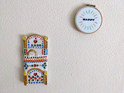 decorative embroidery hoop hanging on wall with kids ceramic decoration