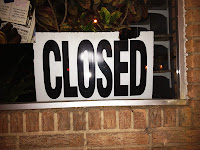 """Closed"" sign in a business window."