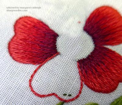 Completed split stitched outline on needlepainted upper petal.