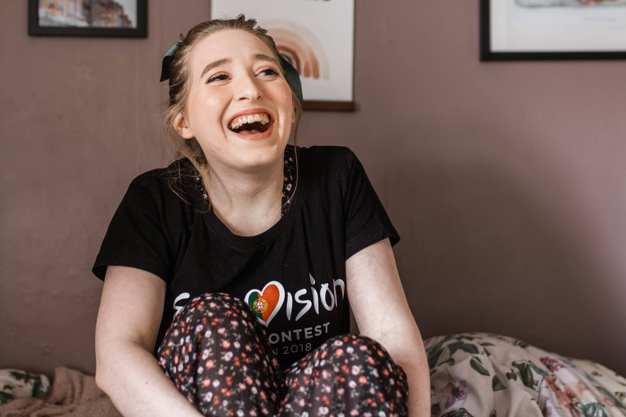girl smiling with eurovision t shirt