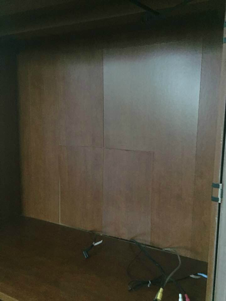 Cardboard back of armoire