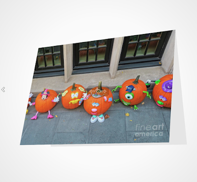 "This image is a screen-shot of my Halloween-themed notecards which is titled ""The Pumpkin Choir."" The picture was taken on the Eastside of NYC in front of a brownstone which was decorated for when for Halloween. It shows an array of pumpkins that have faces painting on them they could be carolers if the season had been Christmas. A copy of this image is featured in volume two of my book series, ""Words In Our Beak."" Info re this series can be found on my blog @ https://www.thelastleafgardener.com/2018/10/one-sheet-book-series-info.html AND info re this particular note-card is can be found on Fine Art America @ https://fineartamerica.com/featured/the-pumpkin-choir-patricia-youngquist.html?product=greeting-card"