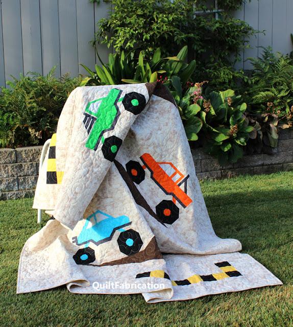 monster truck quilt blocks in a draped quilt