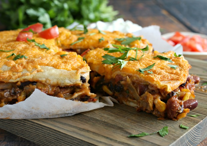 Recipe for layered one pan dinner of  beans, vegetables, sauce, cheese, tortillas and southwestern seasonings.