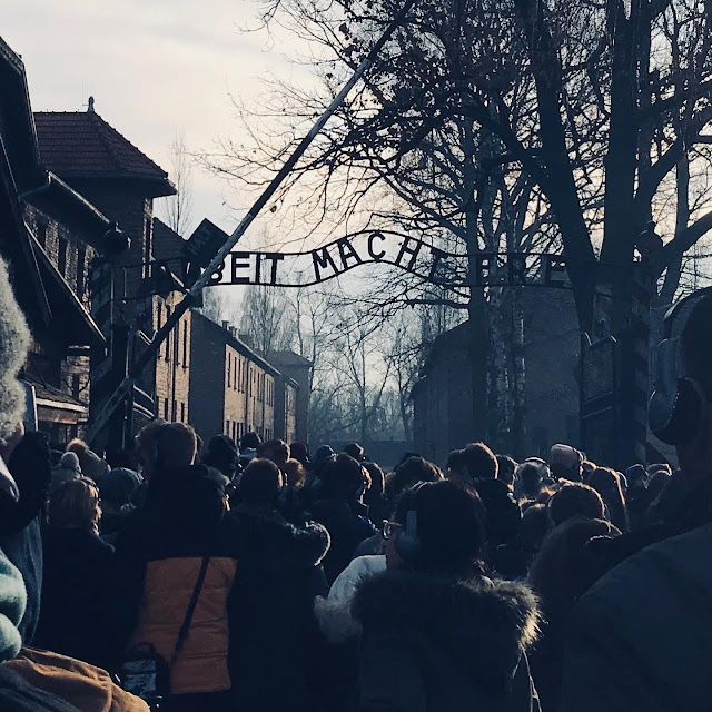 The entrance gate to Auschwitz displaying ARBEIT MACHT FREI above it : My Visit To Auschwitz (and why you should visit too)