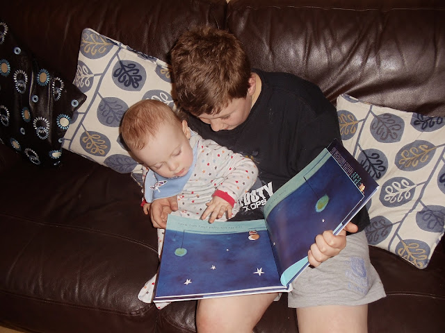 A boy reading to a baby boy How To Catch A Star by Oliver Jeffers Book  activity sheets