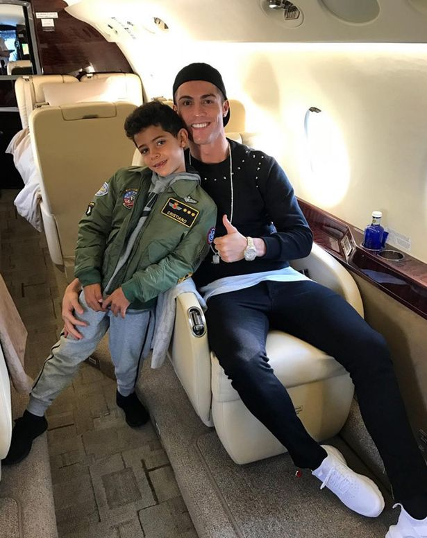 Cristiano-Ronaldo-and-his-son-pose-on-a-plane.jpg
