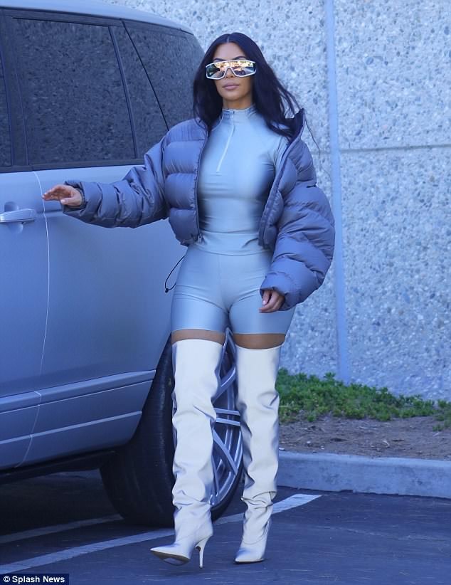 Kim Kardashian shows off curvy figure in clinging bodysuit