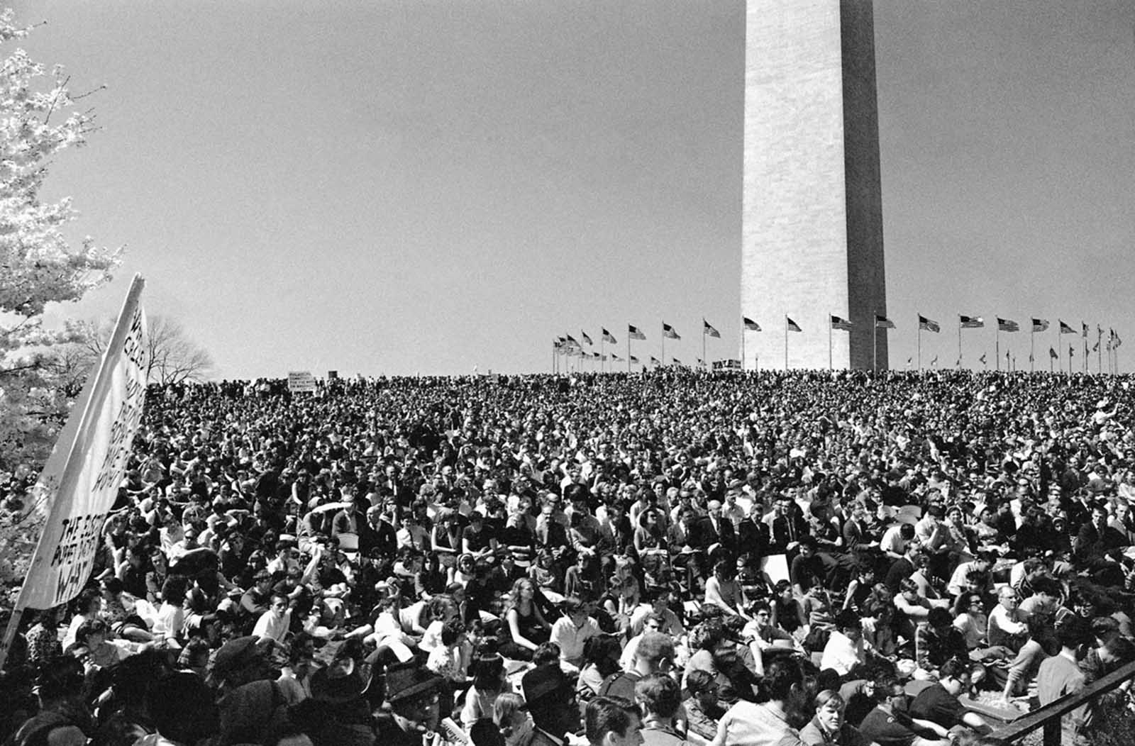 Thousands attend a rally on the grounds of the Washington Monument in Washington on April 17, 1965, to hear Ernest Gruening, a Democratic senator from Alaska, and other speakers discuss U.S. policy in Vietnam. The rally followed picketing of the White House by students demanding an end to Vietnam fighting.