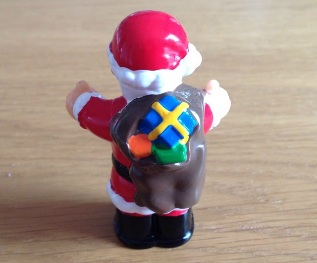 The back of Father Christmas figurine showing presents in his sack