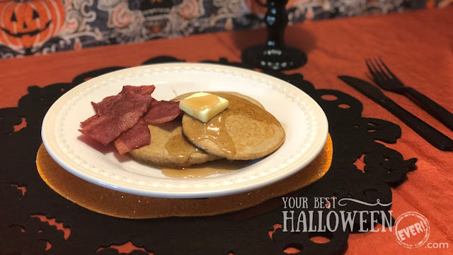 pumpkin spice pancakes with turkey bacon on Halloween place setting