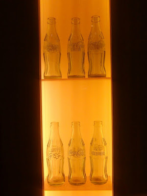 Coke's empty bottles