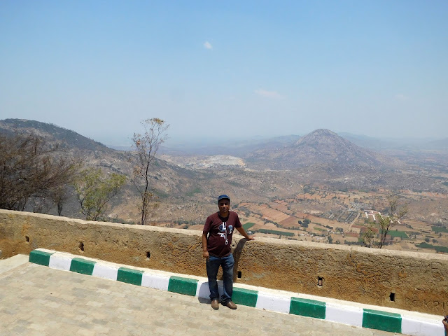 On top of Nandi Hills, leaning against the ramparts of the Nandidurg fort