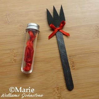 Black trident spear with red satin bow embellishment