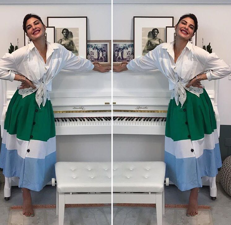 Jacqueline Fernandez in a green Madison Skirt and white shirt