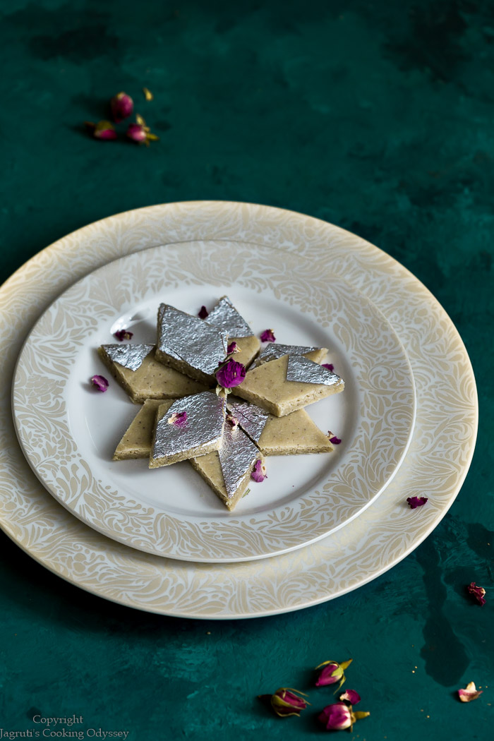 Kaju katli garnished with rose petals served in a plate