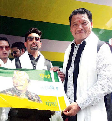 Bimal Gurung hands over Morcha flag to a new entrant to the party in Kalimpong