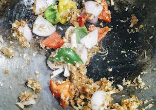 Stir frying ginger garlic onion, bell peppers capsicum for lobster hot garlic recipe