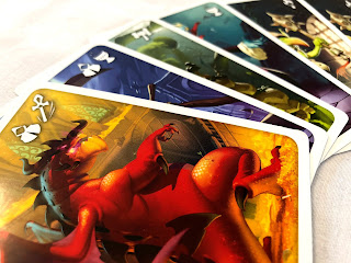 An attractive arrangement of some of the monster cards from Welcome to the Dungeon.