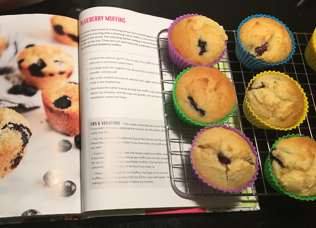 Photo of The Wholesome Yum Easy Keto Cookbook and prepared blueberry muffins recipe